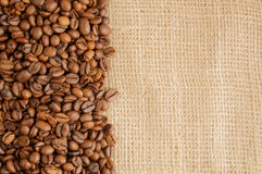 Coffee beans on hessian background Stock Photos