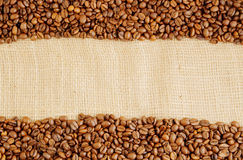 Coffee beans on hessian background Royalty Free Stock Image