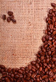 Coffee beans on hessian background Stock Images
