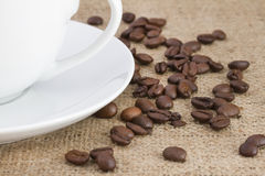 Coffee beans on hessian sack Stock Images