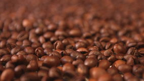 Coffee beans. Horizontal and vertical pan. Close-up. 2 shots stock video footage