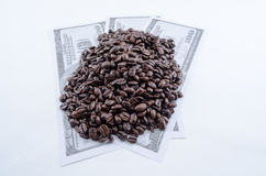Coffee Beans on Hundred Dollar Bills Stock Photography