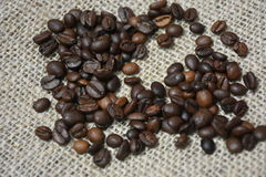 Coffee beans. I love coffee. Coffee beans on canvas background - close up Royalty Free Stock Images