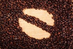 Roasted coffee beans with burlap background Royalty Free Stock Photography