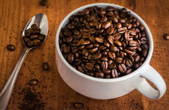 Free Coffee Beans In A White Cup Royalty Free Stock Images - 79017959