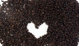 Coffee Beans In Heart Shape On White Background Isolated