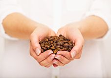 Coffee Beans In Her Hand Royalty Free Stock Photo