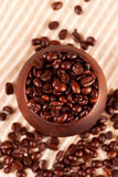 Coffee beans inround wooden bowl royalty free stock photos