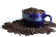 Coffee beans inside mug Stock Photo