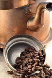 Coffee beans inside the pot lid Stock Images