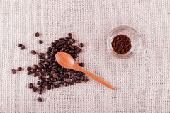 Coffee beans and instant coffee in cup. Stock Photos