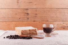 Coffee beans and instant coffee in cup. Royalty Free Stock Photo