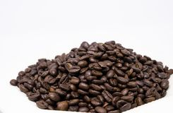 Coffee beans isolated on white background. Close up of coffee beans isolated on white background Stock Photography