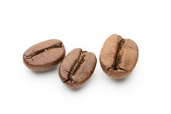 Coffee beans isolated on white background, closeup, macro Royalty Free Stock Images