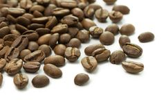 Coffee beans isolated on a white background. Roasted coffee beans isolated on a white background Stock Images