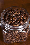 Coffee beans in a jar. Roasted coffee beans in a jar Stock Photos