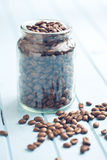 Coffee beans in jar Stock Photos