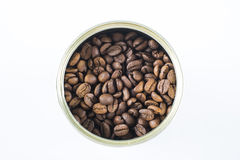 Coffee beans in the jar. Top view, isolated in white Stock Image