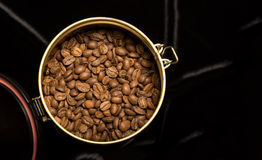 Coffee beans in a jar on a velvet fabric Royalty Free Stock Photos