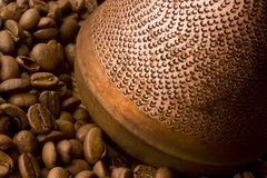 Coffee beans and jezve. Macro. Stock Image