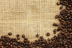 Coffee beans on juta background Stock Image