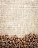 Coffee beans juta background Stock Photo