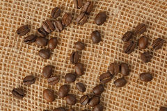 Coffee beans on jute Stock Images