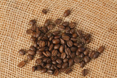 Coffee beans on jute Royalty Free Stock Images