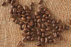 Coffee beans on jute Royalty Free Stock Photos