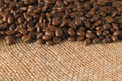Coffee beans on jute. Photo shot of coffee beans on jute Royalty Free Stock Image