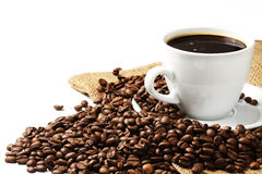 Coffee and beans with jute Stock Photos