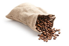 Coffee beans in jute bag. On white background Royalty Free Stock Photography