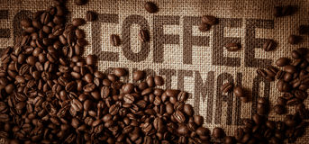 Coffee beans on jute bag Royalty Free Stock Photo