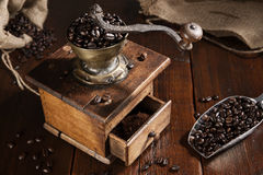 Coffee beans in jute bag with coffee grinder Stock Photos