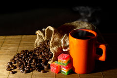 Coffee beans,jute bag,cup of coffee and jelly Royalty Free Stock Photography