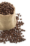 Coffee beans in a jute bag. Jute bag full of coffee beans on white background Stock Photo