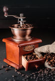 Coffee beans in jute bags with coffee grinder Royalty Free Stock Photography