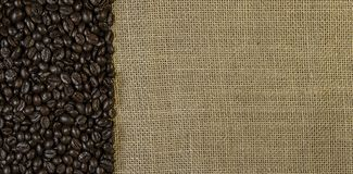 Coffee beans on jute cloth royalty free stock photography
