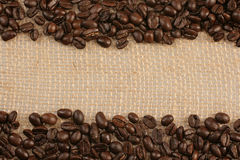 Coffee  beans on jute sack. Coffee beans on background of  jute sack with space for text Royalty Free Stock Photography