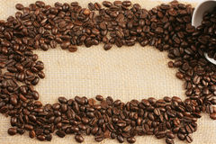 Coffee  beans on jute sack. Coffee beans on background of  jute sack with space for text Royalty Free Stock Photo
