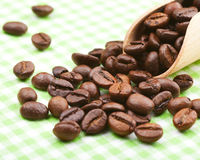Coffee beans on kitchen table Stock Photo