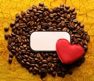 Coffee beans with label and heart Stock Photography