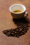 Coffee beans lead the way. To the coffee cup Royalty Free Stock Photo
