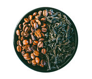 Coffee beans and the leaves of black tea isolated on white. Background Royalty Free Stock Image