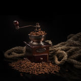 Coffee beans with coffee mill Royalty Free Stock Photography