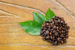 Coffee beans with leaves. Top view Stock Photo