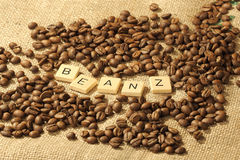 Coffee beans, and the letters BEANZ on a hessian background. Melbourne 2017 stock images