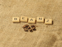 Coffee beans, and the letters BEANZ on a hessian background. Melbourne 2017 royalty free stock photography