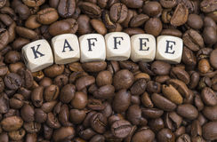 Coffee beans with letters Royalty Free Stock Images