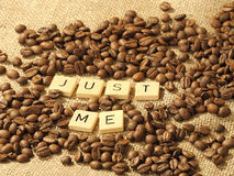 Coffee beans, and the letters JUST ME on a hessian background. Melbourne 2017 royalty free stock photography